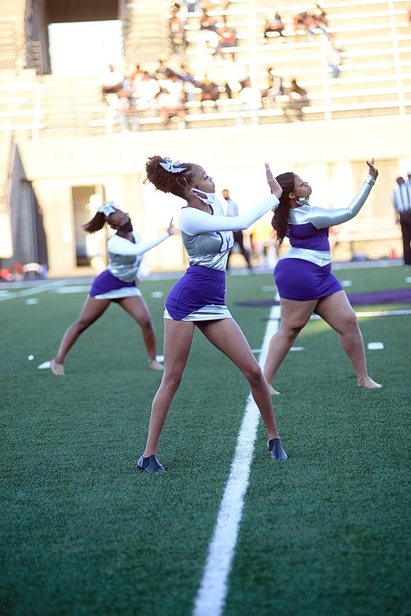 The dance team practices socially distancing while they perform during halftime of the first football game of the season.