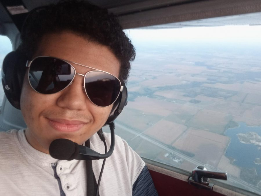 Senior Brendan Wolski behind the controls of a Cessna-152.