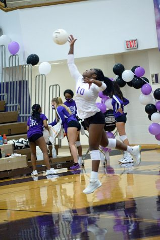 Senior Raven Edwards jumps for the ball during the match on Senior Night.