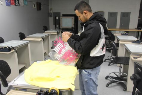 Nathan Salazar Mota works on his signature T-shirts in the Print Shop.