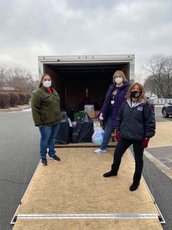 Student Government Co[sponsors Ms. Lena Kiser, Mrs. Sheryl Loving and Ms. Cheryl Austin begin packing gifts in a truck to take to an elementary school.