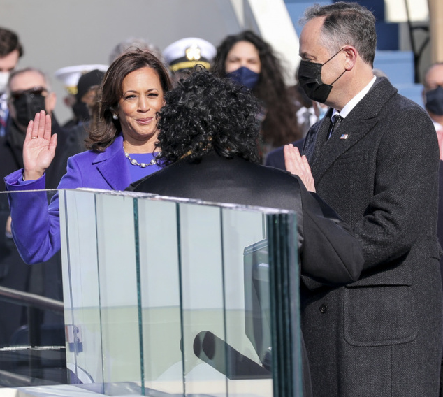 Kamala Harris takes the oath of office as the country