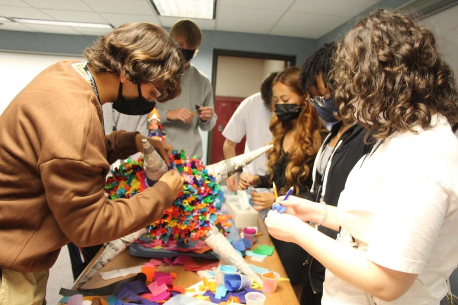 Students in Spanish Heritage class work on a pinata in honor of Hispanic Heritage Month.