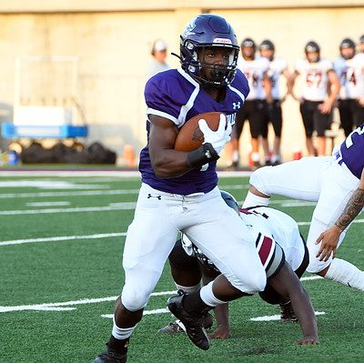 Senior running back Lavarion Logan breaks a tackle against Andrean. Logan ran for four touchdowns in that game.
