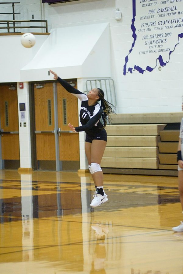 Senior Saniya Spalding serves the ball during a recent match.