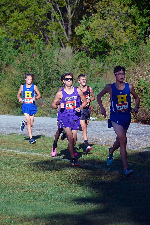 In one of his first races back after an extended illness, Zack Dun runs with the pack in the Highland Invitational.